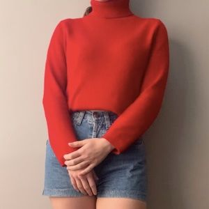 Red cashmere turtleneck sweater